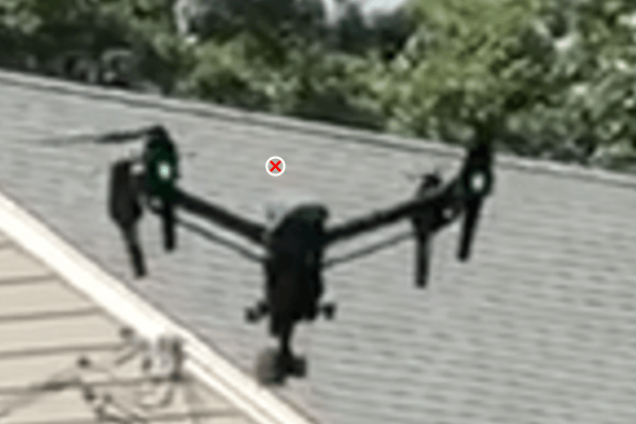 Drone in front of a roof